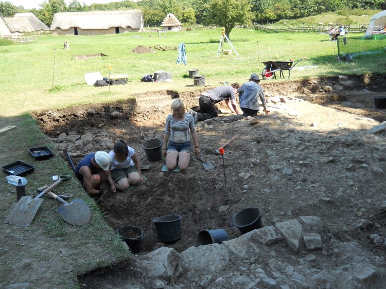 After the clay was cleared the team cleaned up, and in the process, discovered the curved wall feature mentioned above