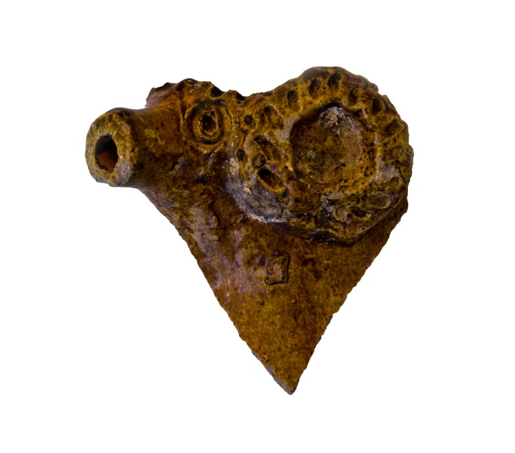 medieval green glazed rams head